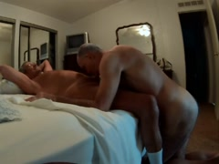 Bruce naked on his knees sucking Jack's cock
