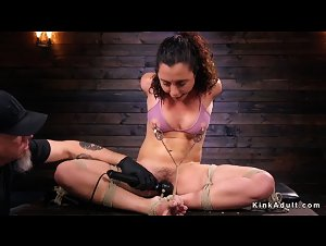 Hogtied on her back brunette tormented
